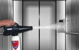 spraying disinfectant elevator coronavirus